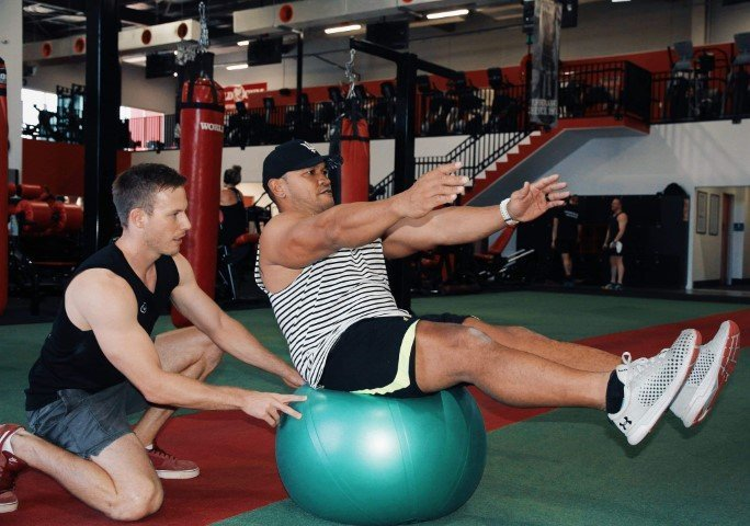 core strength training - sit ups on a fit ball